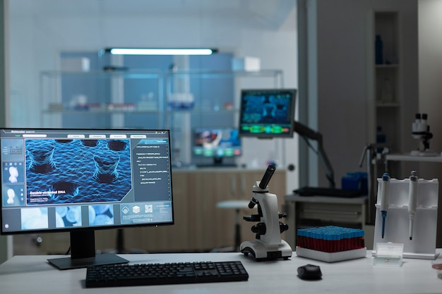 Computer with microbiology virus expertise on display standing on table