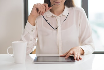 Concentrated businesswoman or student networking on pc tablet
