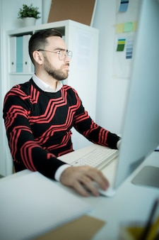 Concentrated designer in office