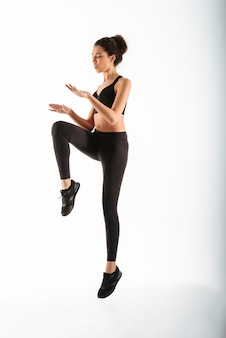Concentrated fitness woman jumping