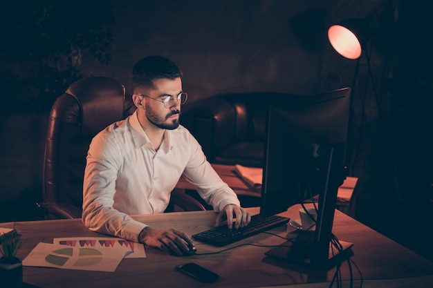 Concentrated focused man sit work typing pc