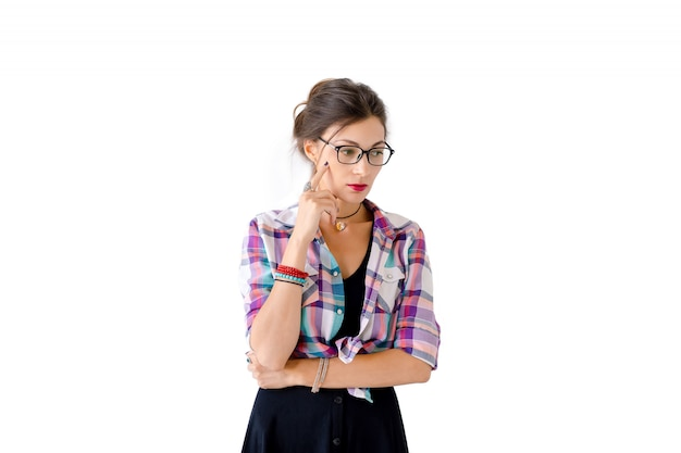 Concentrated girl with glasses look to copy space on left