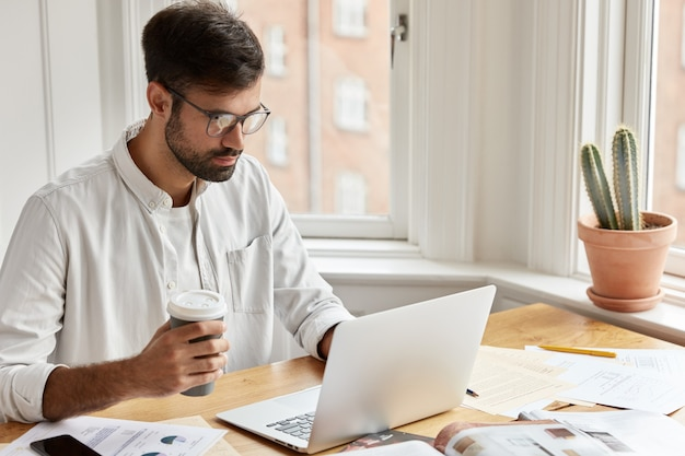 Concentrated male executive manager working at home