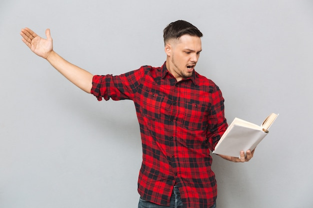 Concentrated man rehearses with book
