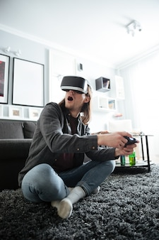 Concentrated man sitting at home indoors play games