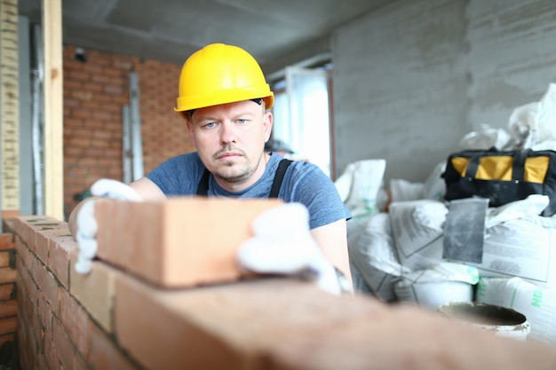 Concentrated man with brick