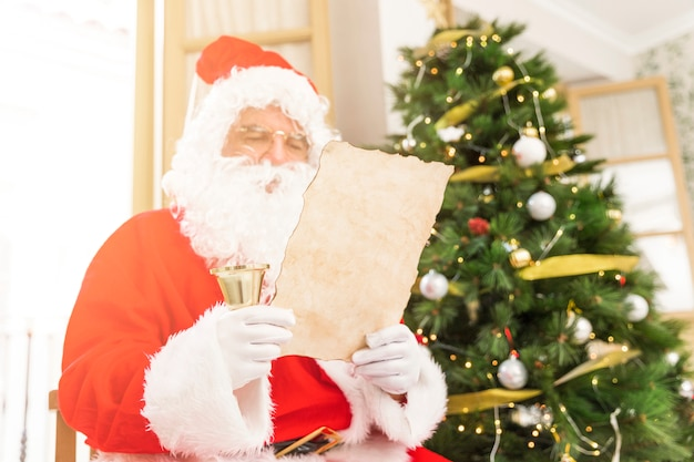 Concentrated santa claus reading letter