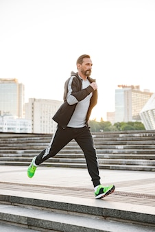 Concentrated sportsman running outdoors
