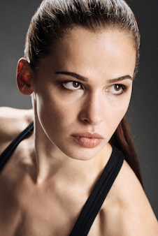 Concentrated woman posing in sportswear