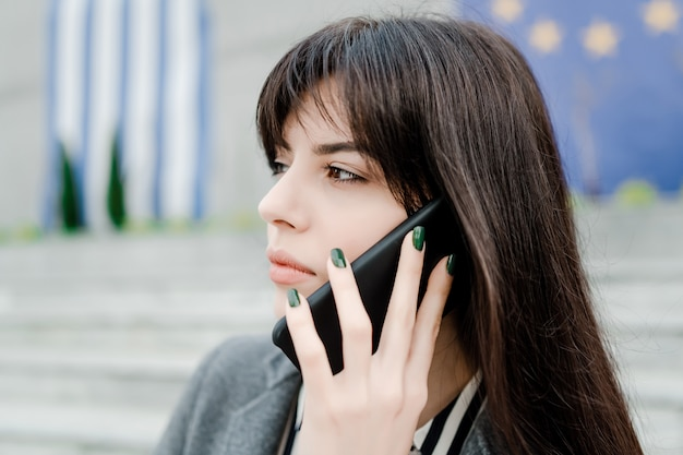 Concentrated woman talking on the phone
