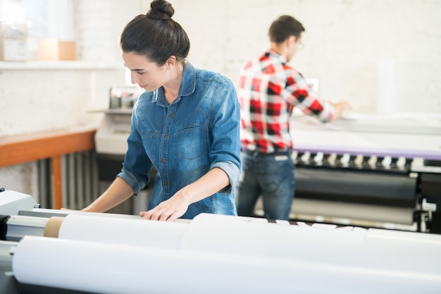 Concentrated woman working in printing office