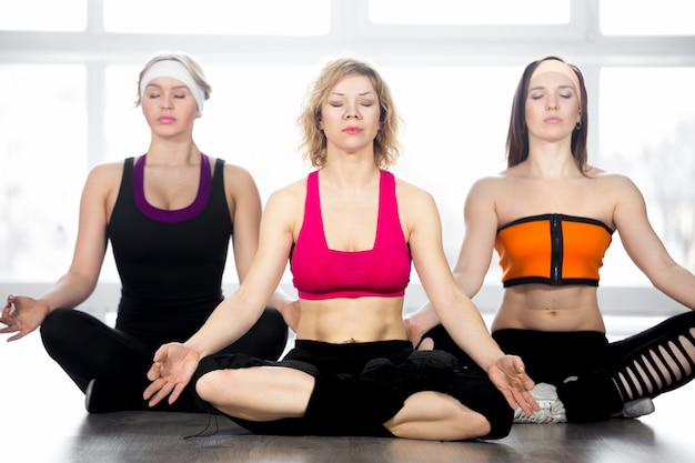 Concentrated women in yoga class