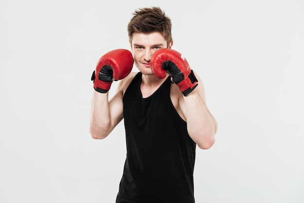 Concentrated young sportsman boxer
