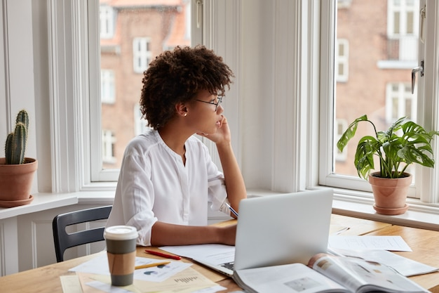 Concentrated young successful businesswoman working at home