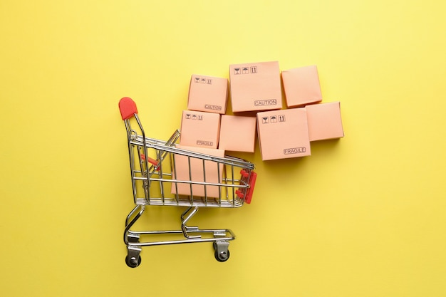 Concept of abstract shopping cart with boxes of goods.