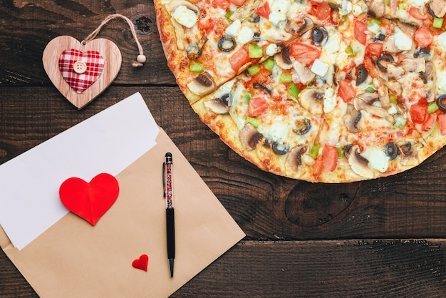 The concept of an advertising banner for valentine's day pizza as a gift with space for text