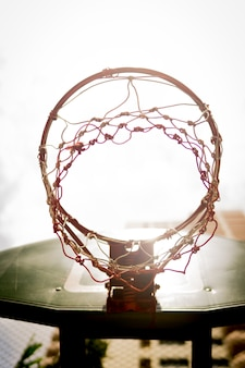 Concept of the basketball hoop in sunlight for goal success