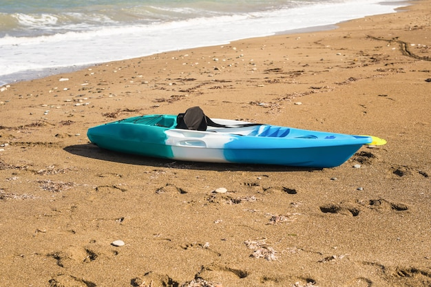 Concept of beach activity, water sport and kayaking.