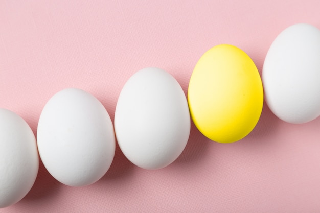 Concept of being unique. one egg painted in yellow.
