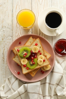 Concept of breakfast with sweet toast with fruits