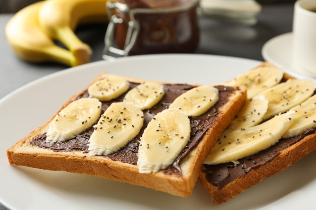 Concept of breakfast with toast with banana, close up