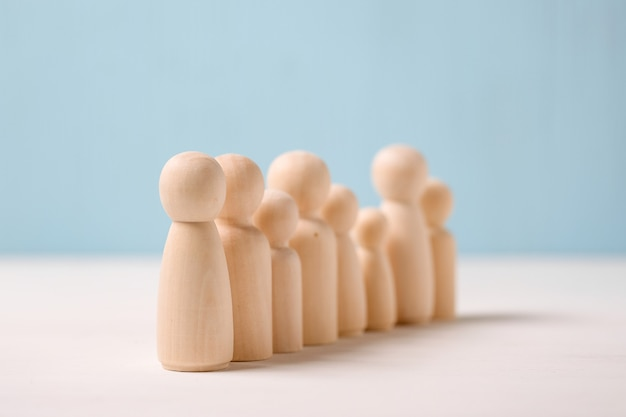 The concept of candidates for work. wooden figures lined up in a row.