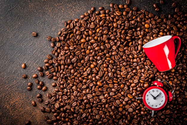 Concept of a cheerful, good start to the day, morning coffee. coffee beans, an alarm clock