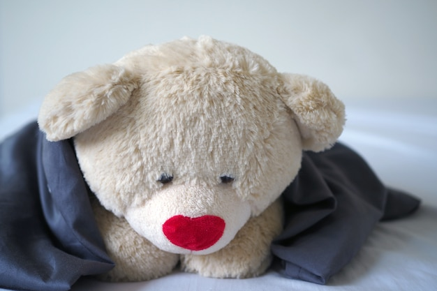 The concept of child sorrow teddy bear lying alone, sad and disappointed