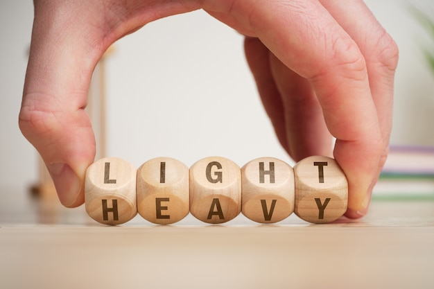The concept of choice is light and heavy on wooden cubes, turns over by hand.