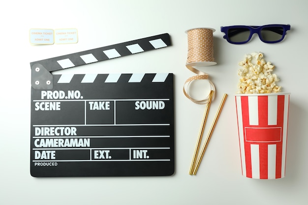 Concept of cinema accessories on light background.