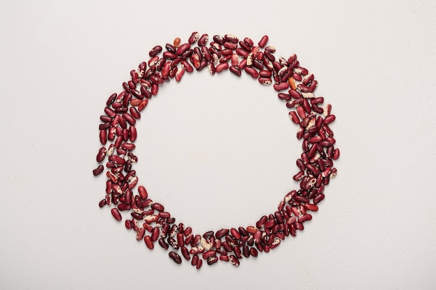The concept of the circle of red beans in the center of the place for text healthy diet food