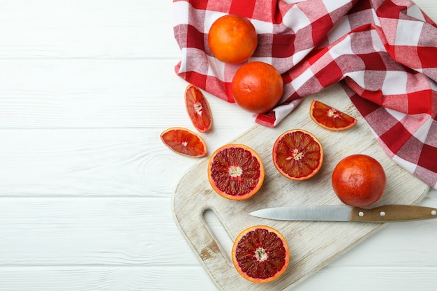 Concept of citrus with red oranges on white wooden table