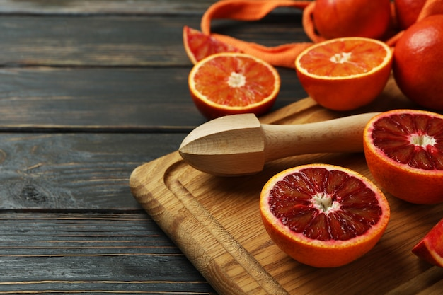 Concept of citrus with red oranges on wooden table