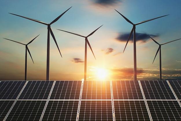 개념 청정 에너지. 바람 터빈과 일출 배경에서 태양 전지 패널