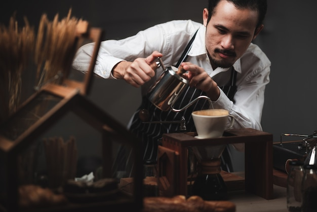 Concept of coffee drip filter process with coffeemaker, vintage style cafe