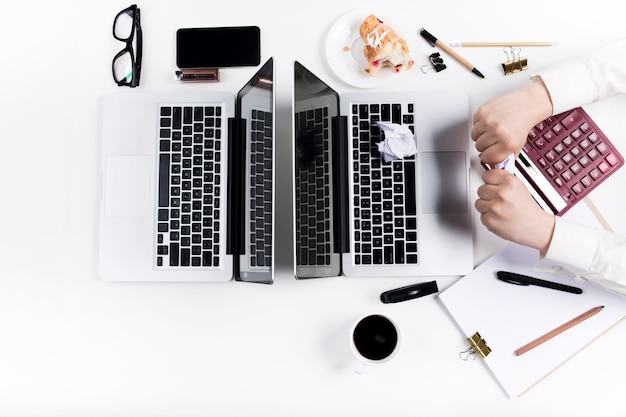 Concept of comfortable male and female workplaces. gadgets on the white desk
