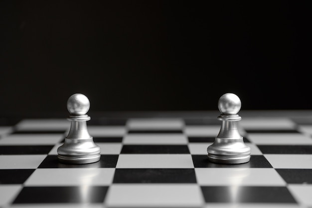 The concept of a confrontation of two pawns on a chessboard.