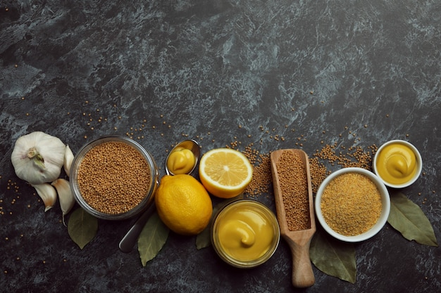 Concept of cooking mustard on black smoky isolated background