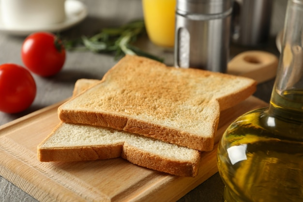 Concept of cooking toast on gray table