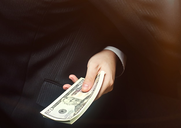 The concept of corruption and bribery, law and money. dark business. businessman receives money