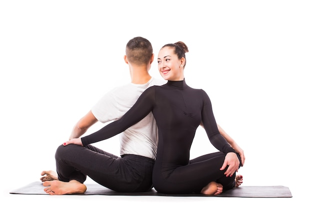 Concept of couple yoga. young healthy couple in yoga position on white background