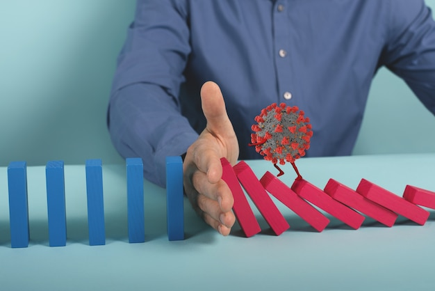 Concept of covid19 coronavirus pandemic with falling chain like a domino game. contagion and infection progression.
