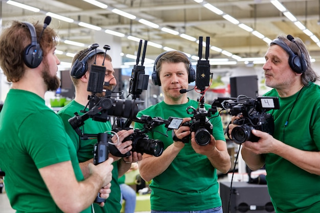 The concept of creating video content, a group of professional operators