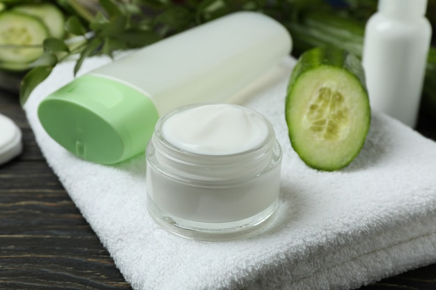 Concept of cucumber cosmetics on wooden table