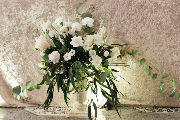 Concept of decor for weddings and holidays, floral arrangements on the table of fresh flowers.