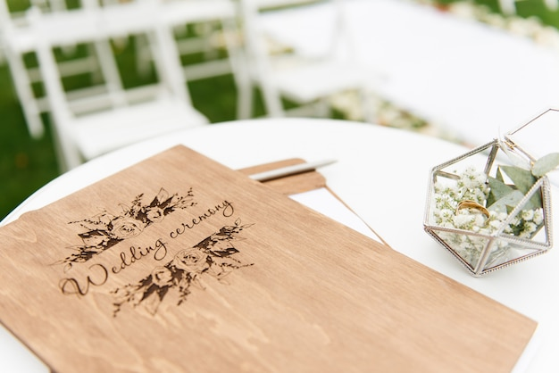 Concept of decoration for wedding and holiday wood folder for the wedding ceremony