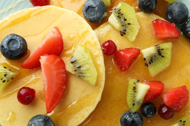 Concept of delicious dessert with pancakes, close up