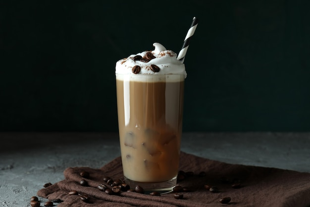 Concept of delicious drink with ice coffee on gray textured table