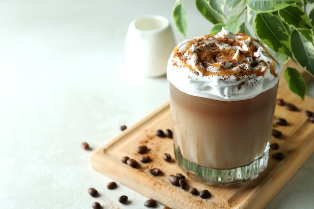 Concept of delicious drink with ice coffee on white textured table