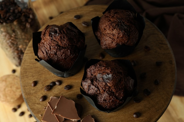 Concept of delicious food with chocolate muffins, close up.